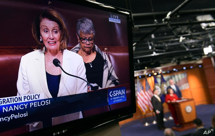 House Minority Leader Nancy Pelosi of California, is shown on television as she speaks from the House floor on Capitol Hill in Washington, Feb. 7, 2018.