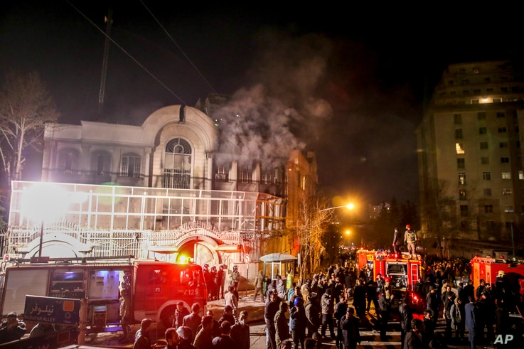 Smoke rises as Iranian protesters set fire to the Saudi embassy in Tehran, Sunday, Jan. 3, 2016. Protesters upset over the execution of a Shiite cleric in Saudi Arabia set fires to the Saudi embassy in Tehran.