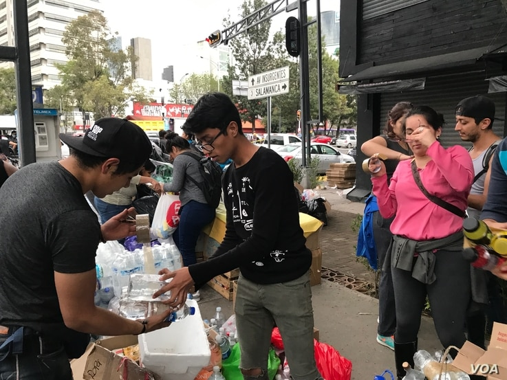 Volunteers collect and package donations to send to those affected by the earthquake that struck Se pt. 19, 2017 in Puebla, 123 kilometers south in Mexico City. The 7.1 magnitude quake has killed at least 225 people and trapped many in collapsed buil...
