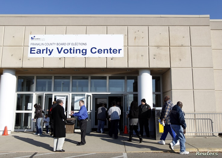 Voters walk into the Franklin County in-person absentee voting location to cast their ballot in Columbus, Ohio November 5, 2012.