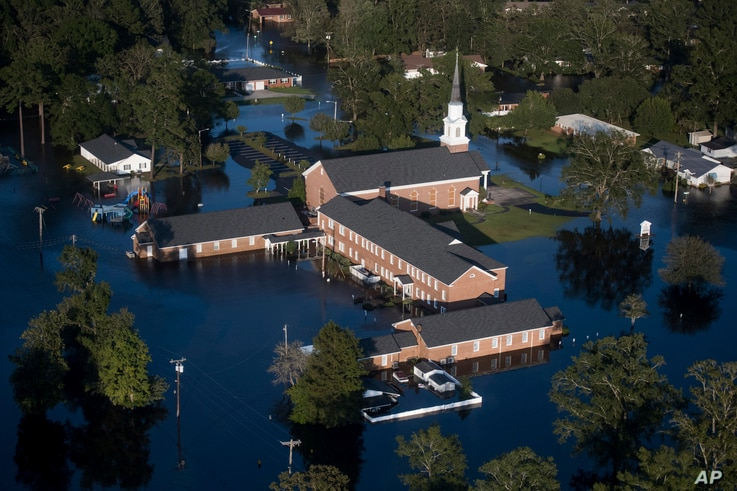 Floodwaters inundate a church after Hurricane Florence struck the Carolinas Monday, Sept. 17, 2018, in Conway, S.C.