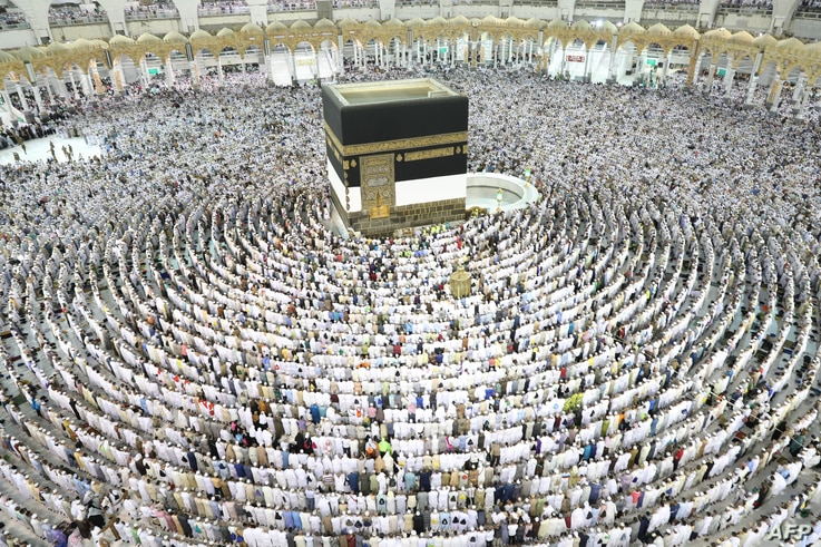 Muslim worshippers perform prayers around the Kaaba, Islam's holiest shrine, at the Grand Mosque in Saudi Arabia's holy city of Mecca on August 15, 2018, prior to the start of the annual Hajj pilgrimage in the holy city.