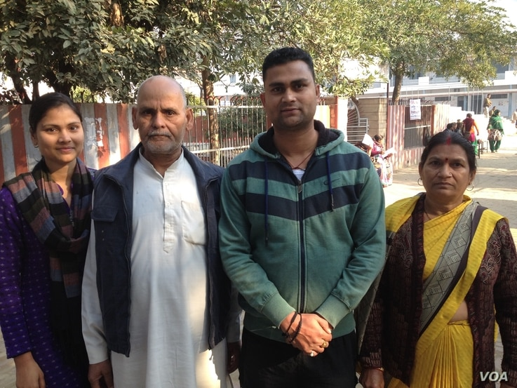 Piyush Rai (2-R) says only Prime Minister Narendra Modi's Bharatiya Janata Party can deliver on development and jobs which young people want. (A. Pasricha/VOA)