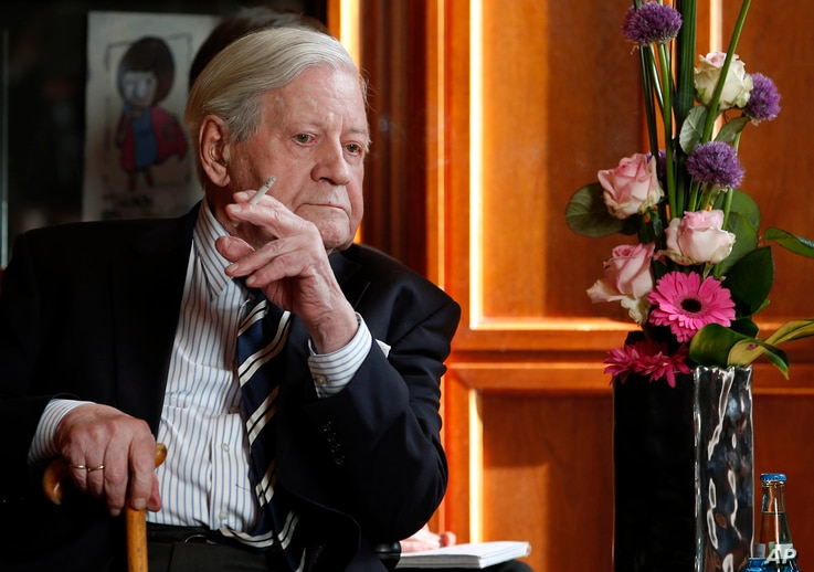FILE - Former German Chancellor Helmut Schmidt attends a meeting with the Prime Minister of China, Li Keqiang, unseen, in Berlin, Germany, May 27, 2013.