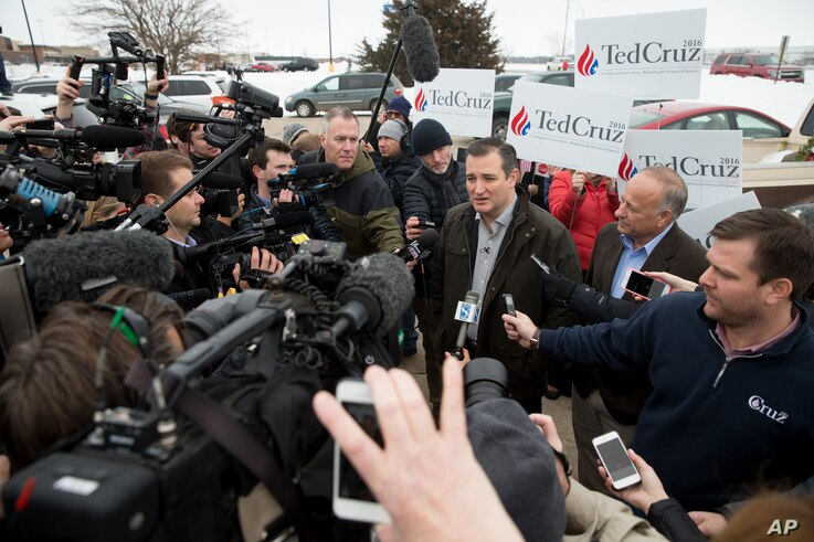 FILE - Members of the media gather around Republican presidential candidate Sen. Ted Cruz of Texas before a campaign event at King's Christian Bookstore in Boone, Iowa, Jan. 4, 2016.