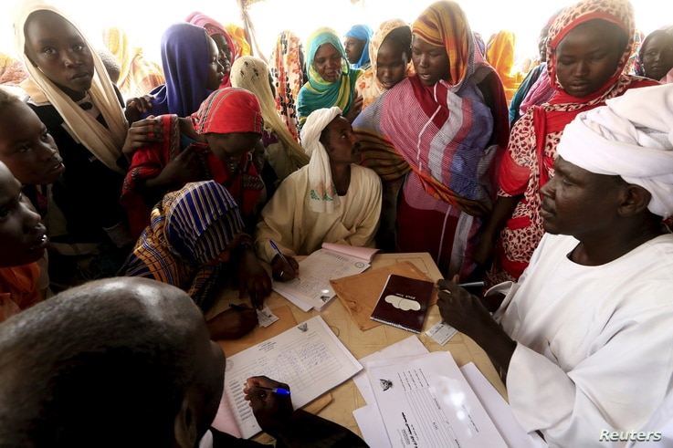 People register for a Darfur referendum, on whether to remain as five states or merge into one, at a registration centre at Abo-Shouk IDPs camp at Al Fashir in North Darfur, Sudan, Feb. 17, 2016.