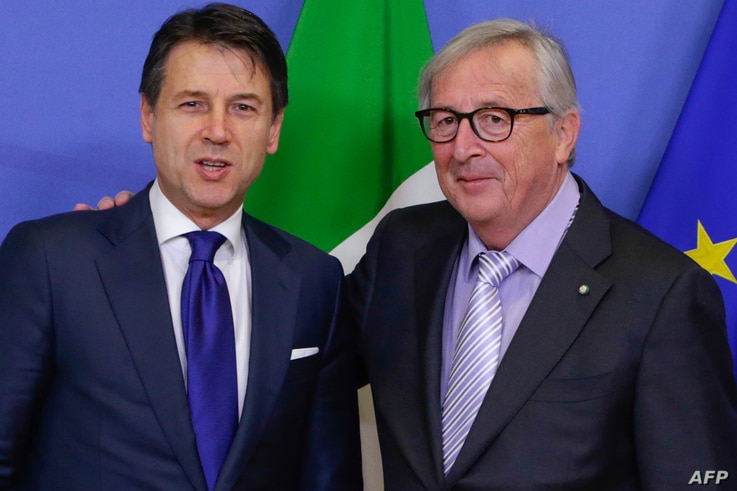 President of the European Commission, Jean Claude Juncker, right, receives Italian Prime Minister, Giuseppe Conte at the European Commission  headquarters, Dec. 12, 2018, in Brussels.
