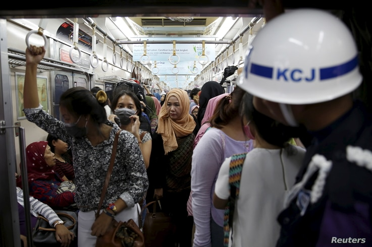 A security personnel stands guard inside a train carriage for women at Manggarai train station in Jakarta, Jan. 8, 2016.