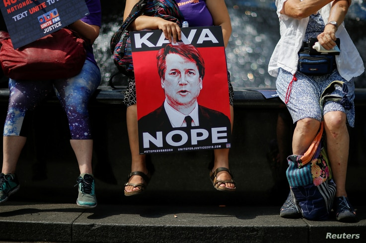 People take part in a protest against Supreme Court nominee Brett Kavanaugh, in front of the New York County Supreme Court at Foley Square in New York City, Aug. 26, 2018.