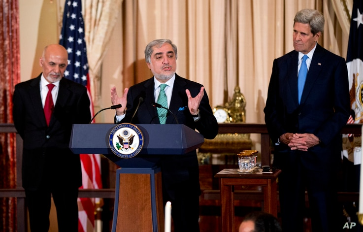 Chief Executive of Afghanistan Abdullah Abdullah, speaks while State Secretary John Kerry, right and Afghan President Ashraf Ghani, left, listen, during a dinner reception at the Department of State, in Washington, Tuesday, March 24, 2015.