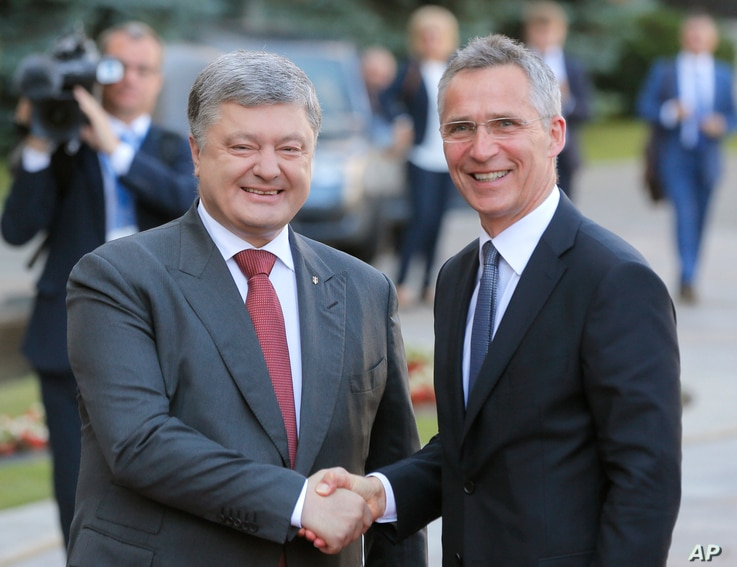 Ukrainian President Petro Poroshenko, left, and NATO Secretary General Jens Stoltenberg, shakes hands during a meeting in Kyiv, July. 10, 2017.