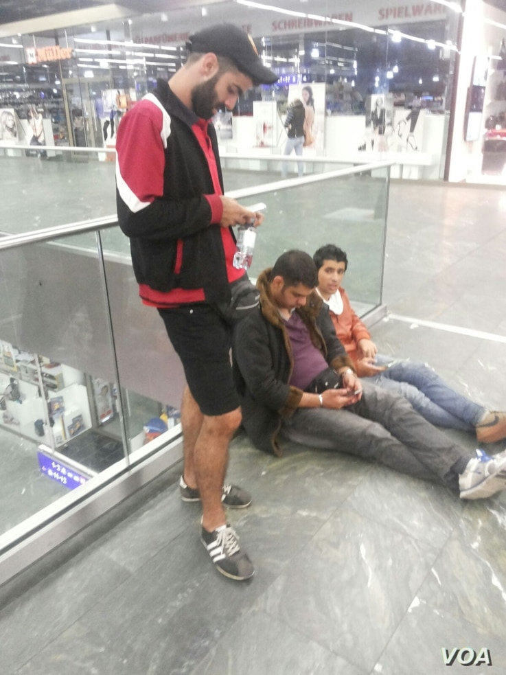In the Vienna train station, after days and nights of non-stop travel, the guys  finally feel safe. Sept. 2015. (VOA/Courtesy)