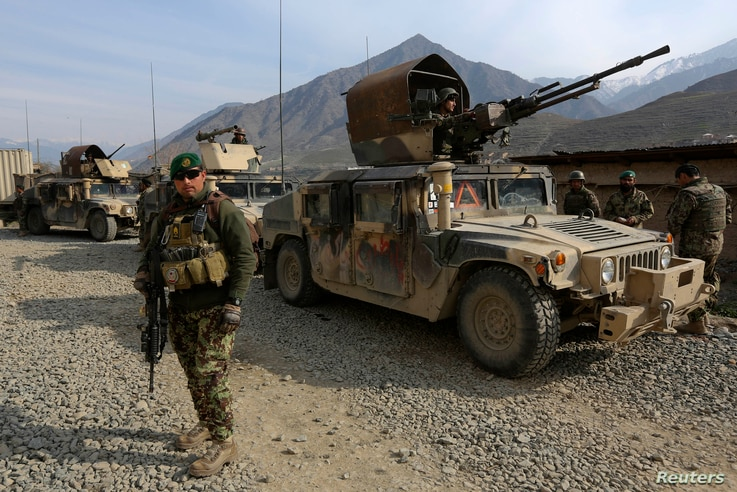 Afghan National Army soldiers keep watch at the Forward Base in Nari district near the army outpost in Kunar province, in this February 24, 2014 file picture.