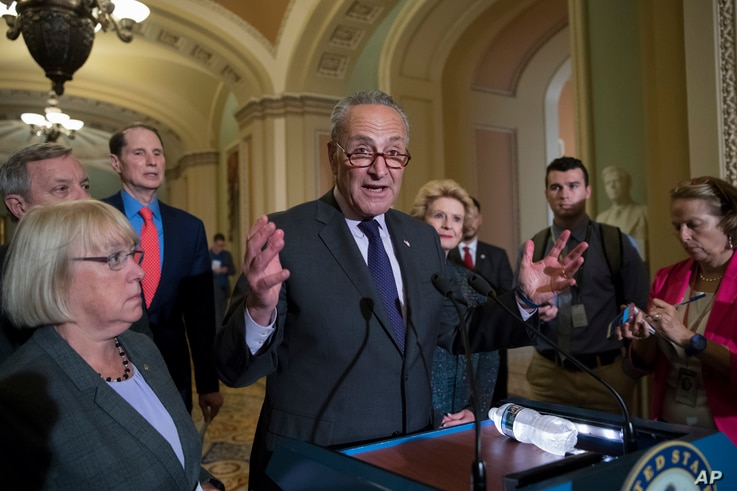 FILE - Senate Minority Leader Chuck Schumer, D-N.Y., joined from left by, Sen. Patty Murray, D-Wash., Sen. Dick Durbin, D-Ill., Sen. Ron Wyden, D-Ore., and Sen. Debbie Stabenow, D-Mich., speaks with reporters about the Obama health care law on Capito...