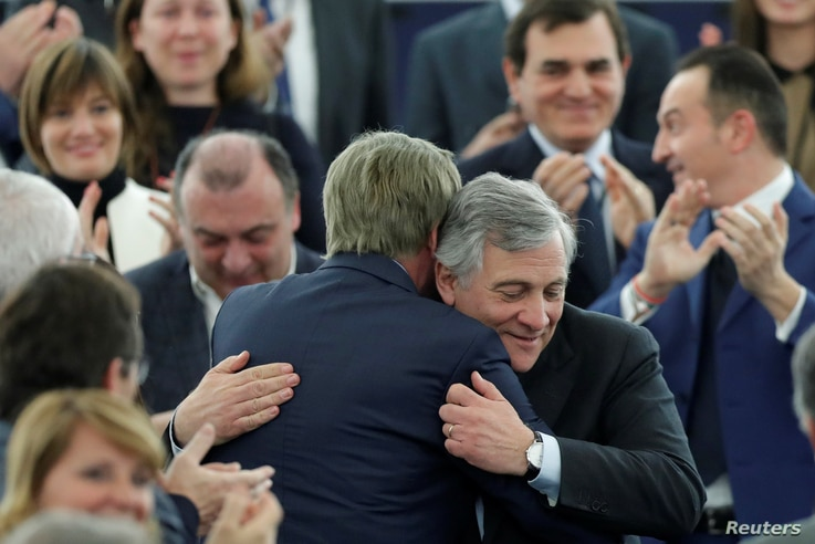 Newly elected European Parliament President Antonio Tajani is congratulated by members of the Parliament. Jan. 17, 2017.