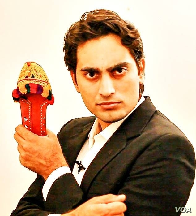 """Danish Ali with a prop used in his video """"Super Chittar"""""""