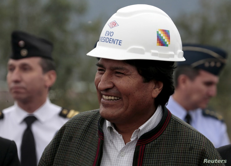 FILE - Bolivia's President Evo Morales smiles during the inauguration of a gas plant in Yacuiba, south of La Paz, Aug. 24, 2015.