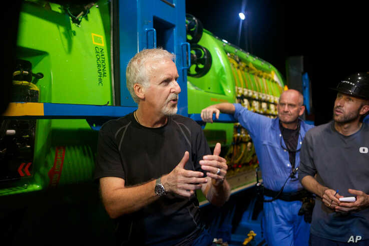James Cameron talks with his crew in front of the DEEPSEA CHALLENGER following testing of the submersible in Jervis Bay, south of Sydney, Australia. The submersible will travel to the bottom of the Mariana Trench as the centerpiece of DEEPSEA CHALLEN