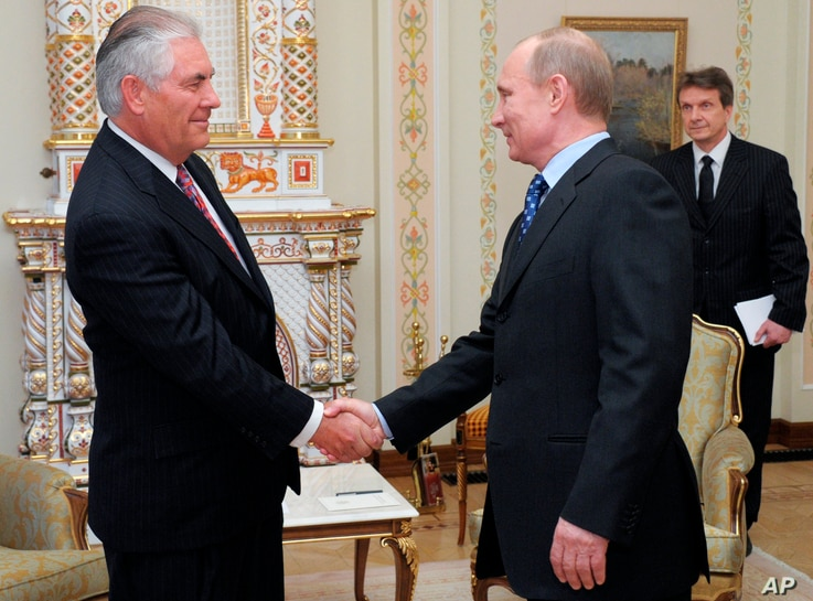Russian Prime Minister Vladimir Putin, right, shakes hands with Rex W. Tillerson, chairman and chief executive officer of Exxon Mobil Corporation at their meeting in the Novo-Ogaryovo residence outside Moscow, Monday, April 16, 2012. Exxon is teaming...