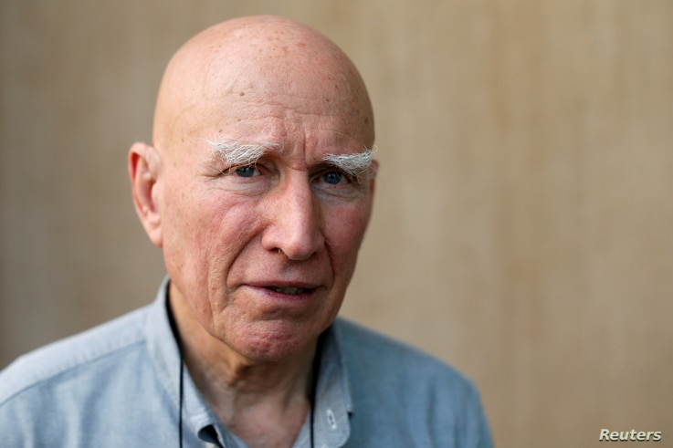 Brazilian photographer Sebastiao Salgado poses for a portrait after an interview with Reuters in Bangkok, Thailand, Feb. 9, 2017.