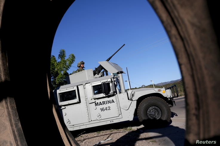 """A soldier mans his machine gun atop an armored vehicle in a checkpoint at the hometown of Joaquin """"El Chapo"""" Guzman in the municipality of Badiraguato, in Sinaloa state, Mexico, Jan.  9, 2016."""