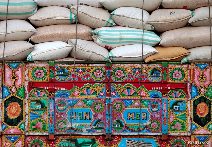Artwork is seen on a decorated truck carrying sacks of wheat in Charsadda, Pakistan, May 1, 2017.