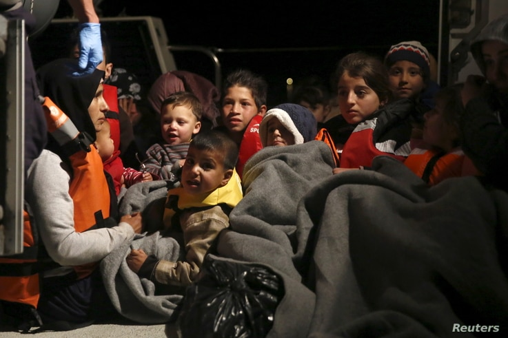 Refugee children are seen onboard a Greek Coast Guard vessel, carrying other refugees and migrants, as it arrives at the port of Mytilene on the Greek island of Lesbos, following a rescue operation at open sea, April 5, 2016.