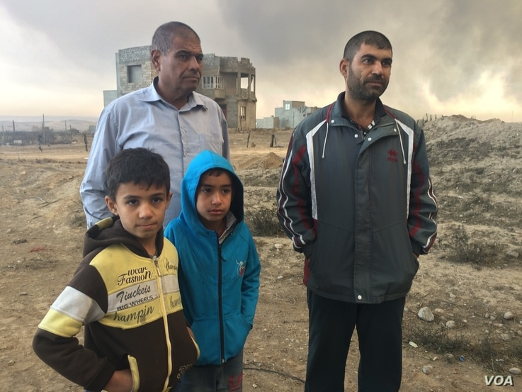 "4283: ""Even our spit is dry and black,"" says one father who's family did not leave the area for Islamic State or the fires.  ""Life here is finished,"" he added, in Qayyarah, Iraq,  Nov. 5, 2016."