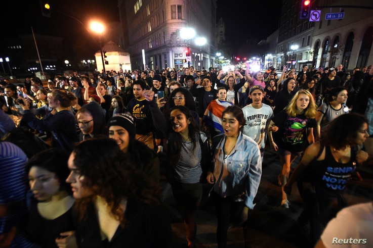 Protesters against president-elect Donald Trump march peacefully through Oakland, California, Nov. 9, 2016.