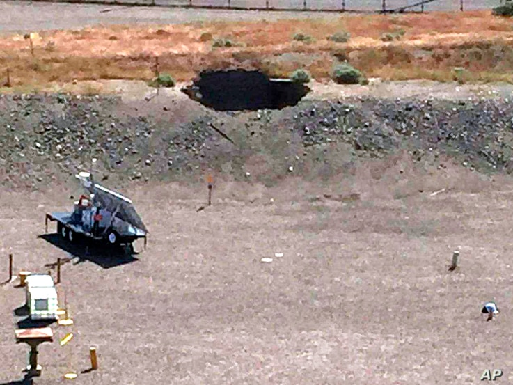 This image provided by the U.S. Department of Energy shows a 20-foot by 20-foot hole in the roof of a storage tunnel at the Hanford Nuclear Reservation near Richland, Washington, May 9, 2017.