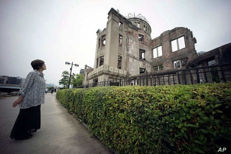FILE - In this July 3, 2015, photo, Kimie Mihara, a survivor of the 1945 atomic bombing, looks at the Atomic Bomb Dome, as it is known today in Hiroshima, Hiroshima Prefecture, southern Japan.