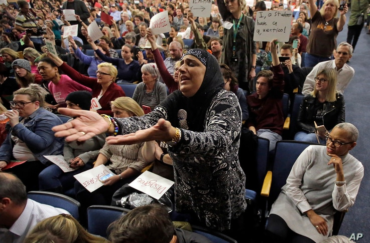 """Noor Ul-Hasan reacts during Rep. Jason Chaffetz's town hall meeting at Brighton High School, in Cottonwood Heights, Utah, Feb. 9, 2017. In an echo of the raucous complaints that confronted Democrats back in 2009 as they worked to pass """"Obamacare"""" in ..."""