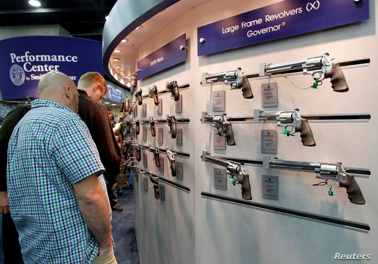FILE: Gun enthusiasts look over Smith & Wesson guns at the National Rifle Association's (NRA) annual meetings and exhibits show in Louisville, Kentucky.