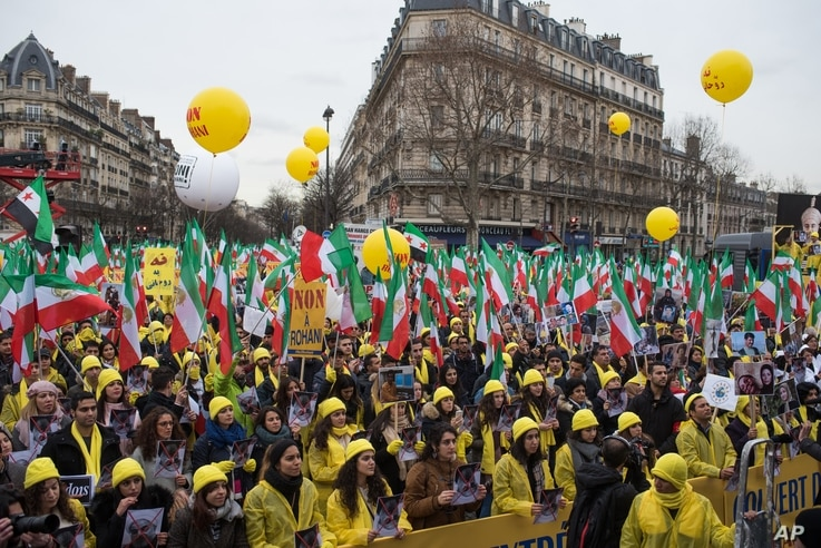 Iranian opposition protesters take the streets in Paris to protest against executions in Iran, as Iranian President Hassan Rouhani is in France for a two-day official visit, Jan. 28, 2016.