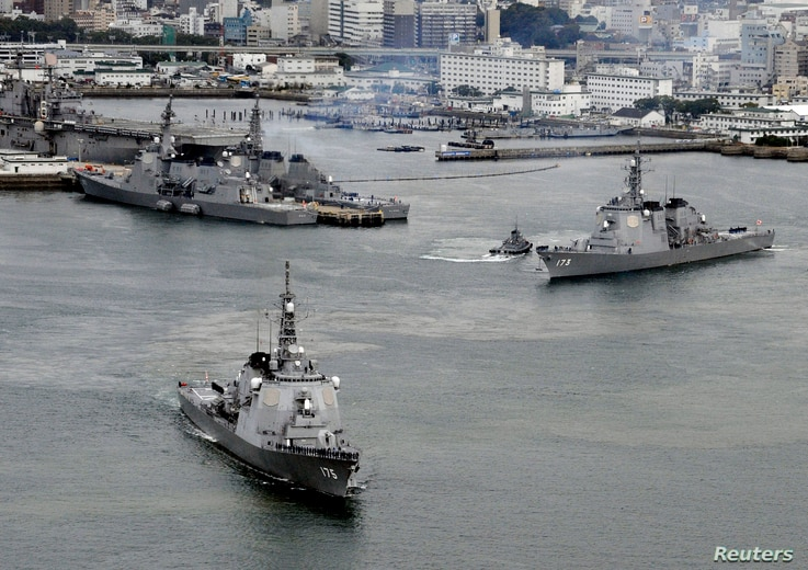 Japan Maritime Self-Defense Force's (JMSDF) Aegis destroyers Myoko (L) and Kongo sail off from the JMSDF Sasebo base in Sasebo, southern Japan, in this photo taken by Kyodo, Dec. 6, 2012.