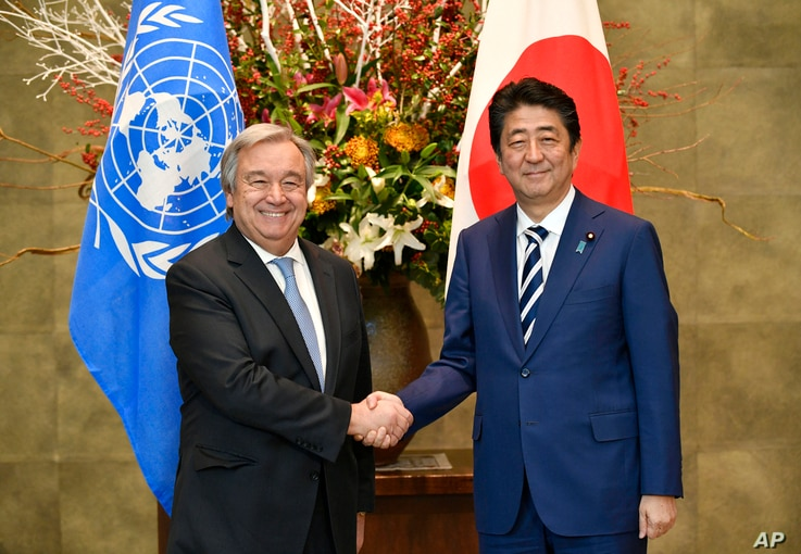 U.N. Secretary-General Antonio Guterres, left, and  Japanese Prime Minister Shinzo Abe pose for a photo before their meeting at Abe's official residence in Tokyo, Dec. 14, 2017.
