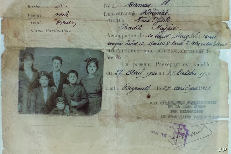 This picture taken Oct. 1, 2016, shows part of the Najjar family's passport. The Najjars were Syrian immigrants who came to the U.S. in 1920. Their passport is shown displayed at an exhibit at the Ellis Island National Museum of Immigration.