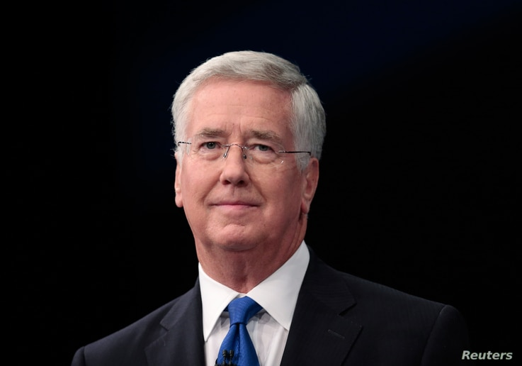 Britain's Defense Secretary Michael Fallon arrives to address the Conservative Party Conference in Manchester, Britain, Oct. 4, 2015.