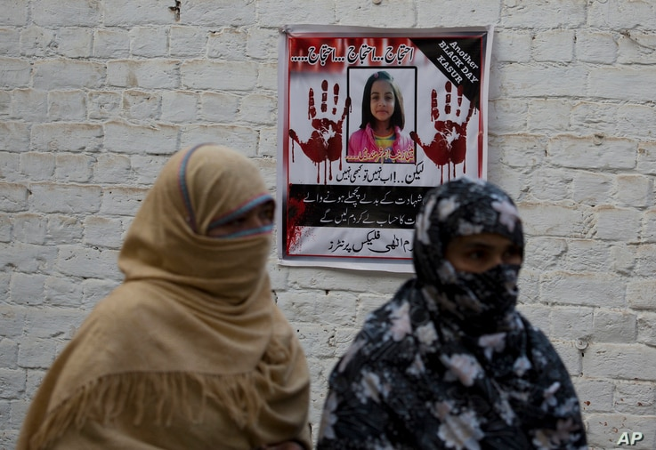 """posters reading """"protest,"""" pasted at walls of a neighborhood of seven-year old Zainab Ansari in Kasur, Pakistan, Jan. 18, 2018."""