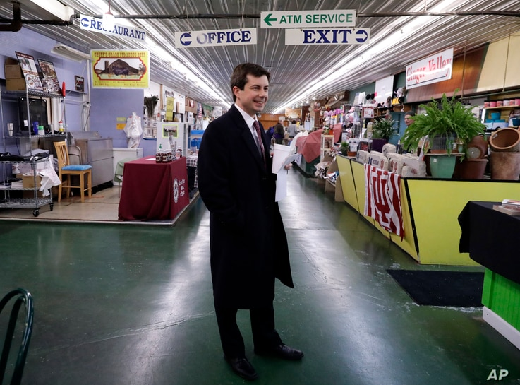 FILE - Mayor Pete Buttigieg walks around as he talks with people at Farmers Market in South Bend, Ind., Jan. 10, 2019. At 37, Pete Buttigieg is just a few years older than the minimum age required to serve as president of the United States.