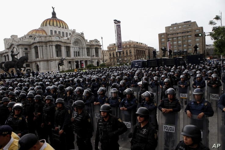 Police in riot gear block a protest march by teachers belonging to a dissident teachers union, in Mexico City, July 5, 2016.