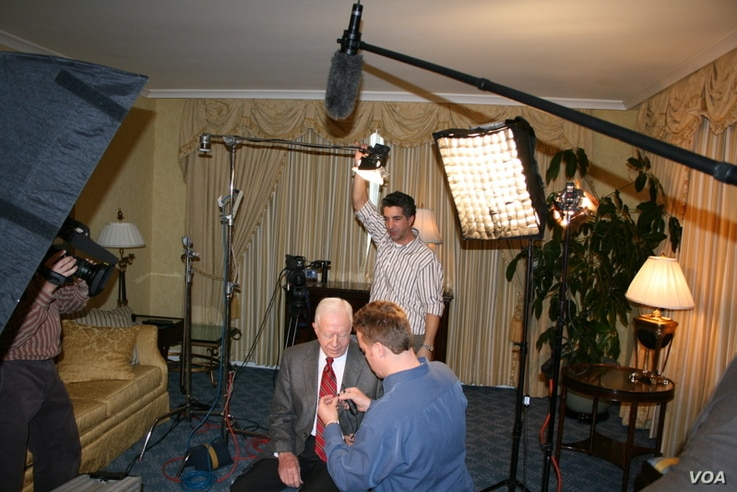 """Preparing President Carter for an interview in 2006 in Chicago during the book tour for """"Palestine: Peace Not Apartheid."""""""