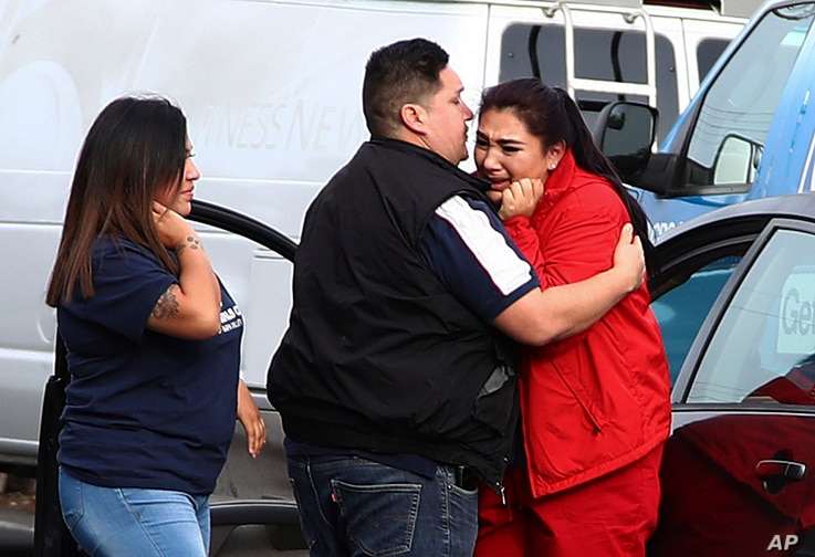 Fernando Juarez, 36, of Napa, center, embraces his 22-year-old sister Vanessa Flores, right, at the Veterans Home of California, March 9, 2018, in Yountville, Calif. Flores, who is a caregiver at the facility, exchanged texts with family while shelte...