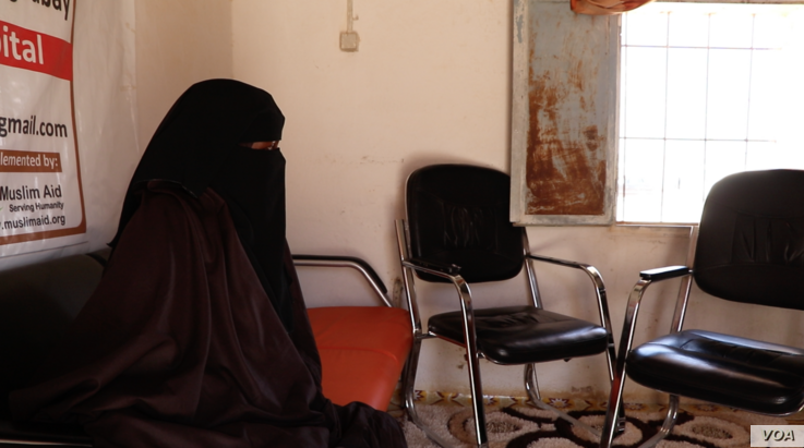 Fatima, who was gang-raped by three strangers outside her family's home in a camp for displaced people in Puntland, waits at a women's health clinic in Garowe.