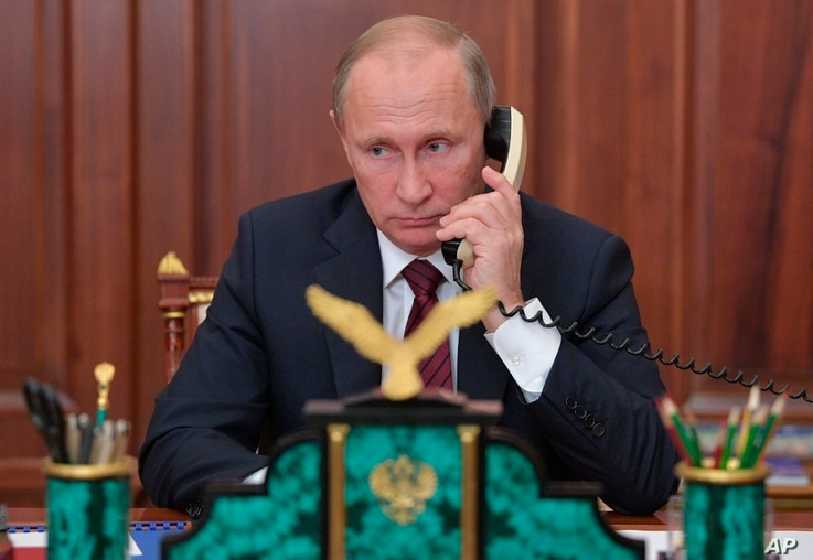 Russian President Vladimir Putin speaks on the phone with Igor Plotnitsky, the leader of pro-Russian rebels in the Luhansk region, and Alexander Zakharchenko, the leader of pro-Russian rebels in Donetsk region in Moscow, Russia, Nov. 15, 2017.