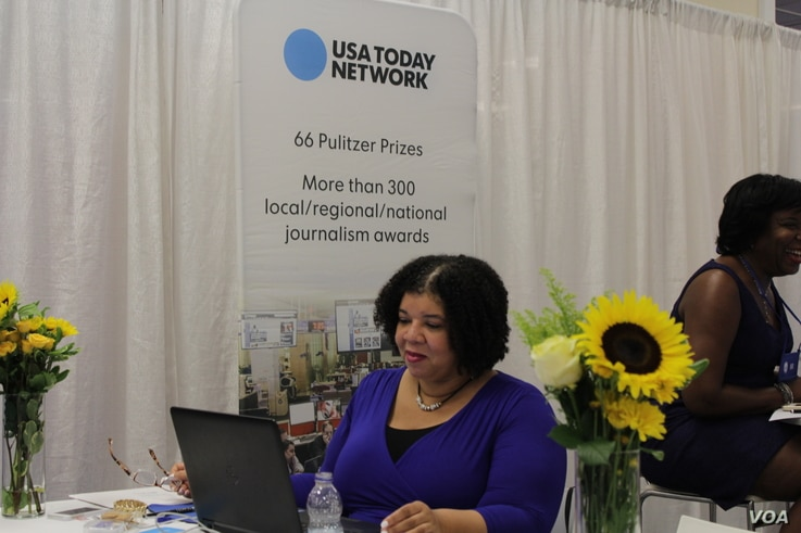 Nichelle Smith, features editor at USA Today Network National News Desk, mans a booth at the National Association of Black Journalists and the National Association of Hispanic Journalists this week in Washington, Aug. 3, 2016.