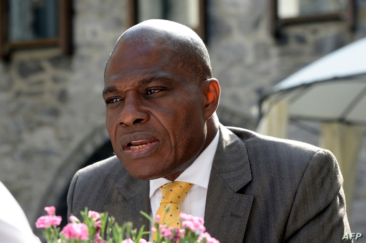 The leader of the DRC opposition party Engagement for Citizenship and Development  Martin Fayulu talks to the media on June 10, 2016 in Genval, outside Brussels.