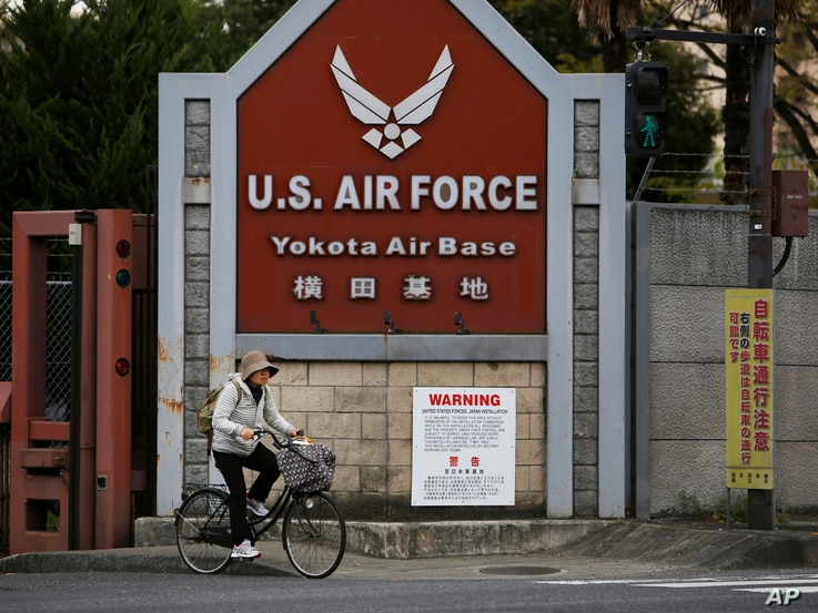 A woman cycles from the U.S. Air Force's Yokota Air Base in Tokyo's western suburbs, April 27, 2017. Residents living near U.S. military bases in Japan are on the frontline of North Korea's dispute with America, and if Pyongyang were to attack the...