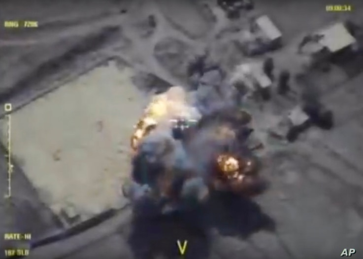 This frame grab provided Sept. 26, 2017, by the Russian Defense Ministry press service shows alleged militants positions being hit in Syria's Idlib province by Russia airstrikes.