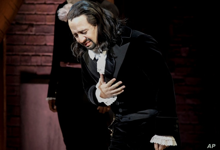 "Lin-Manuel Miranda, composer and creator of the award-winning Broadway musical, ""Hamilton,"" receives a standing ovation with tears at the end of the play's premiere in San Juan, Puerto Rico, Jan. 11, 2019."